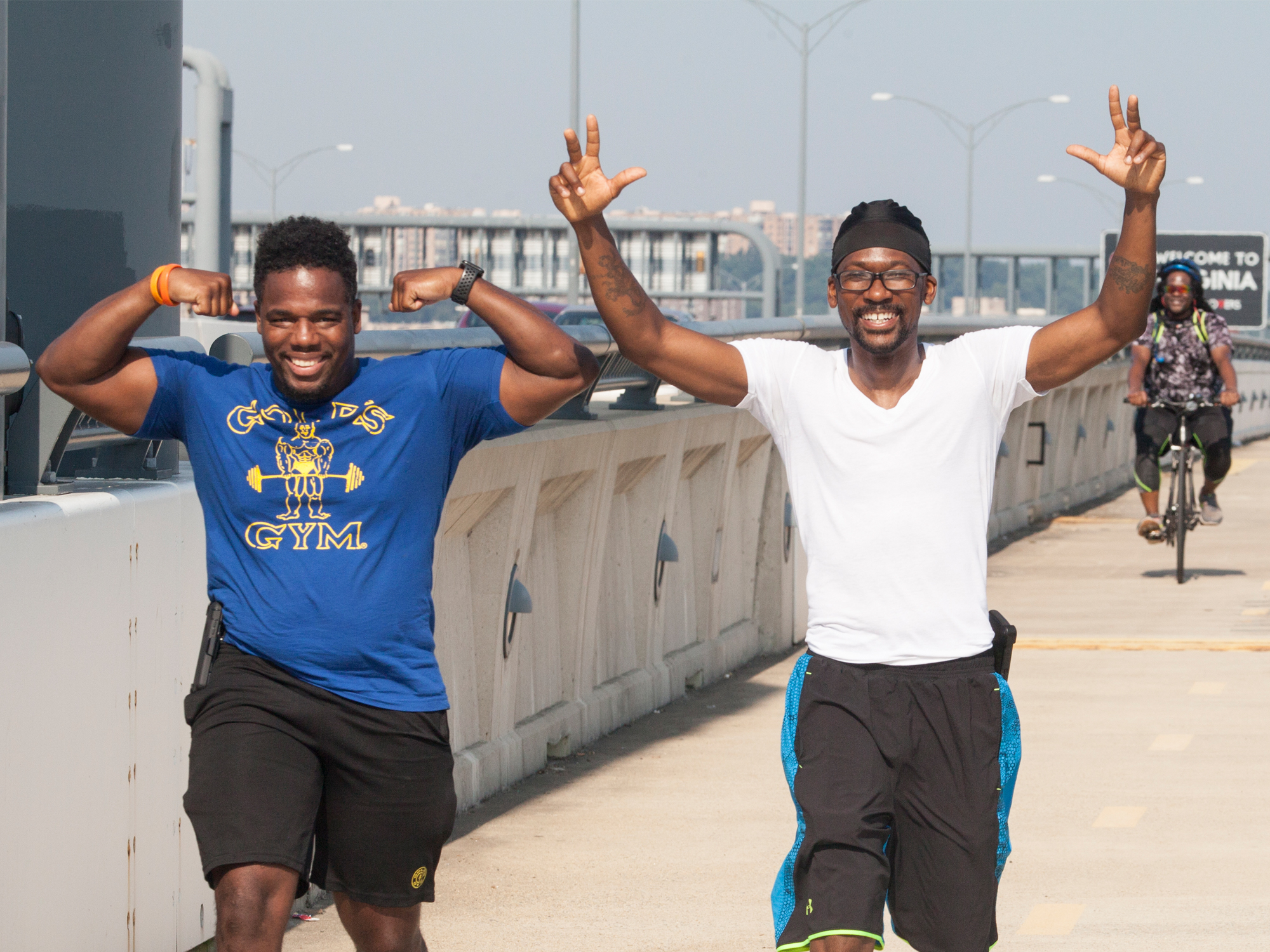 Men Walking in Celebration on Wilson Bridge